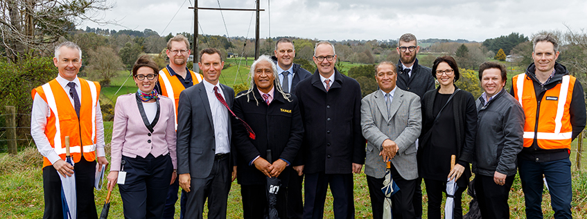 Project team, iwi representatives and guests join Minister Twyford on site this morning.