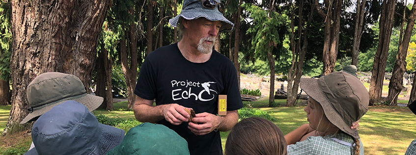 Gerard from Project Echo teaching some local kids about Hamilton's native Long-Tailed Bat