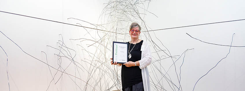Last year's winner of the Fieldays No.8 Wire National Art Award, Waikato artist Gaye Jurisich, with her work Snare.