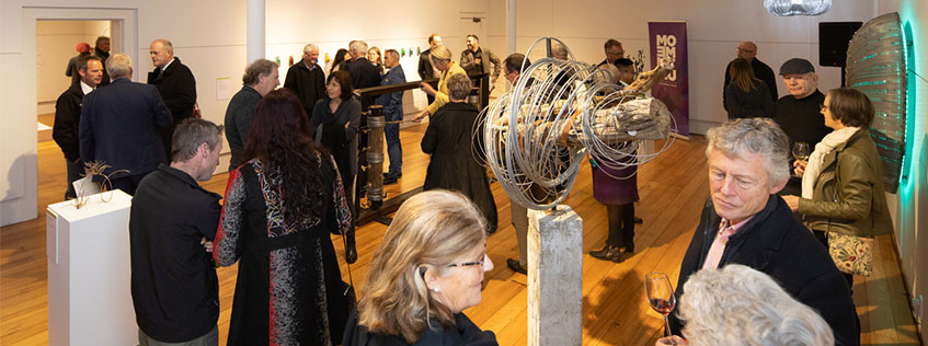 Image: Guests and artists mingling at last year's Fieldays No.8 Wire National Art Award ceremony at Hamilton's ArtsPost Galleries & Shop.