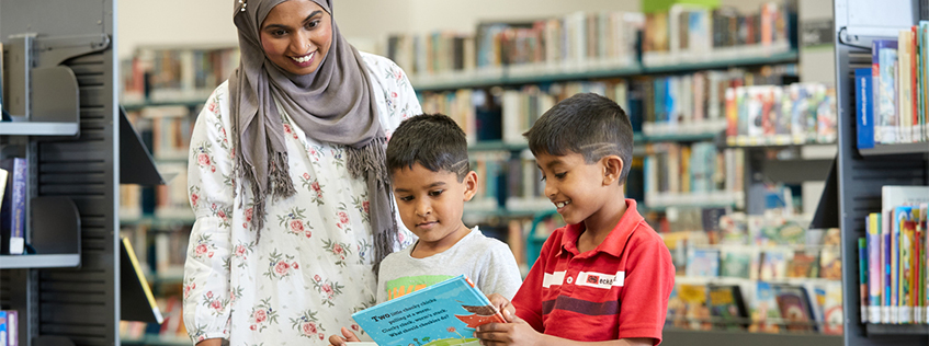Image of children browsing books at the library