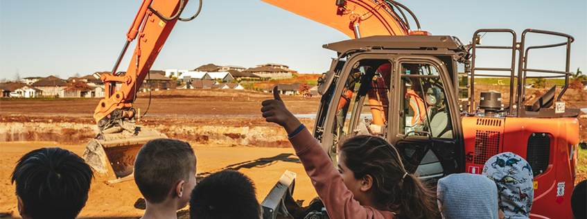 Image of students at Te Ao Mārama school watching a digger