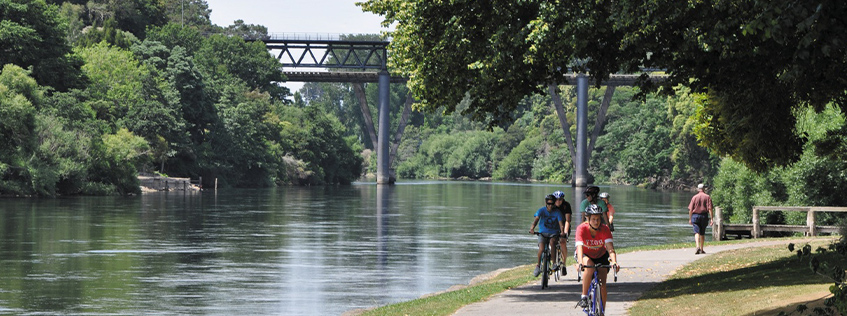 Image of a group of cyclist on the river trail